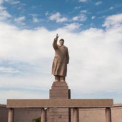 Kashgar, Xinjiang, China - August 14, 2012: A statue of Mao Zedungin